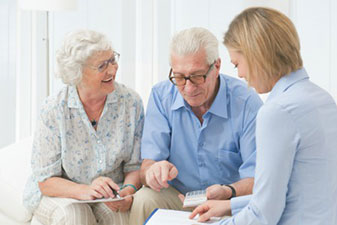 Photo of a couple meeting with an advisor. Link to Life Stage Gift Planner Over Age 65 Gifts.